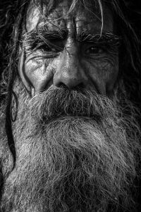 Picture of a weatherbeaten old man with a bushy white beard