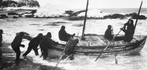 The James Caird Boat being launched in the Antarctic