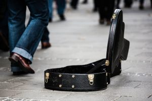 Busker's empty guitar case