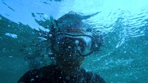 Man in diving mask underwater
