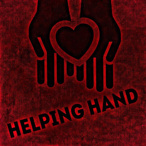 Hands holding a heart, accompanied ny the words 'Helping Hand'
