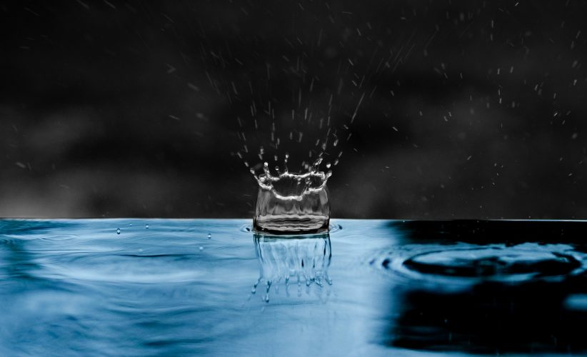 Rain drop on water