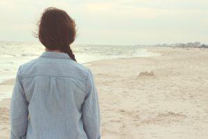 Woman facing away on beach