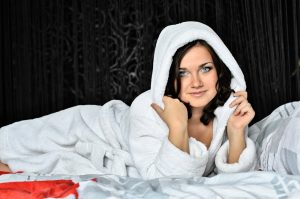 Woman in white dressing gown